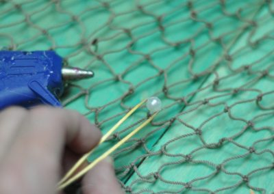 Use tweezers to glue pearls