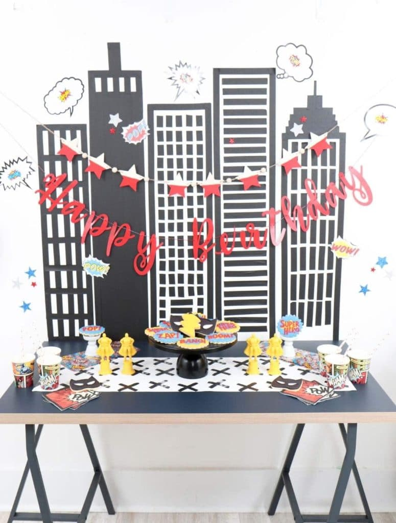 superhero party dessert table and backdrop