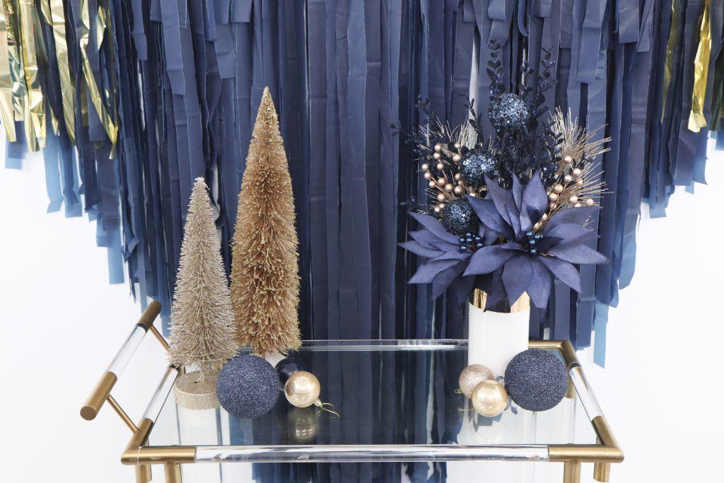 navy and gold holiday backdrop and bar cart