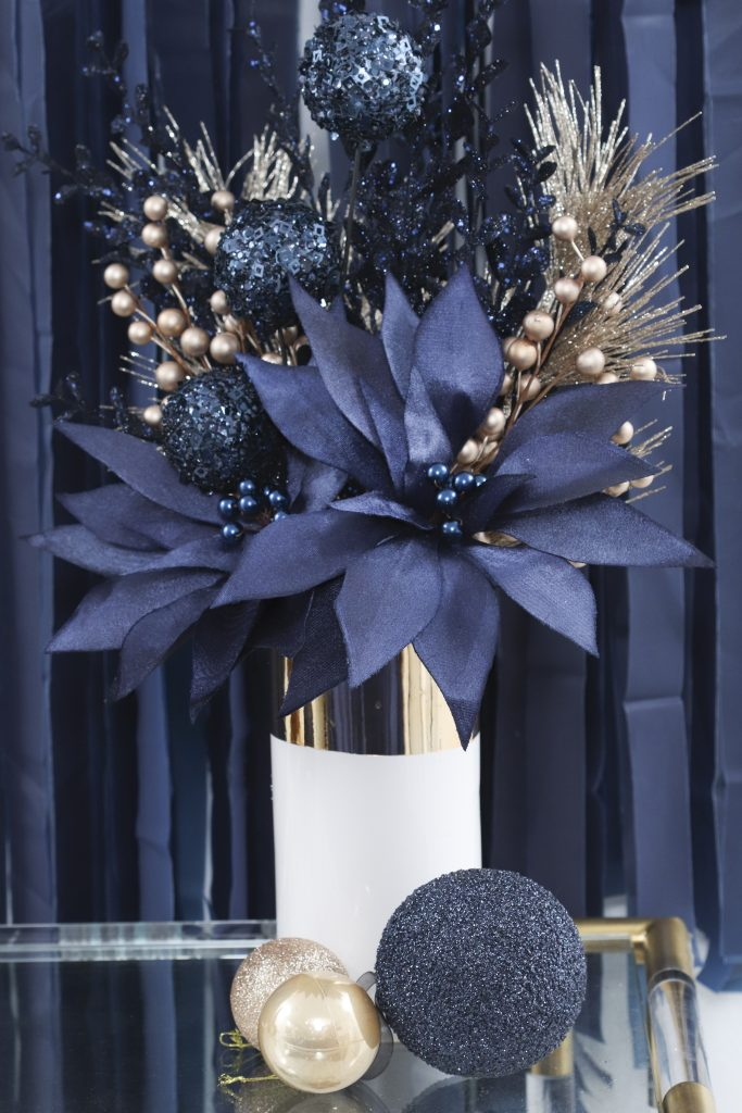 navy and gold holiday poinsettia floral arrangement