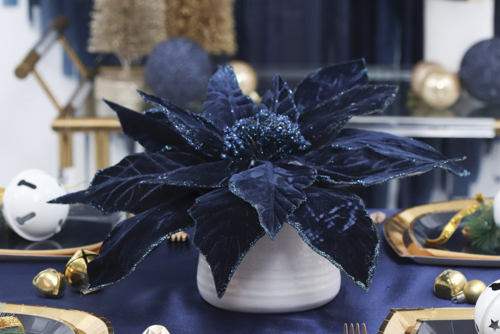 navy and gold holiday table setting centerpiece