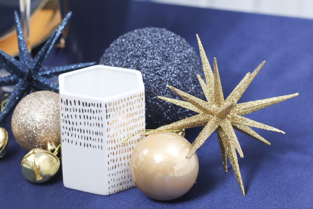 navy and gold holiday table setting