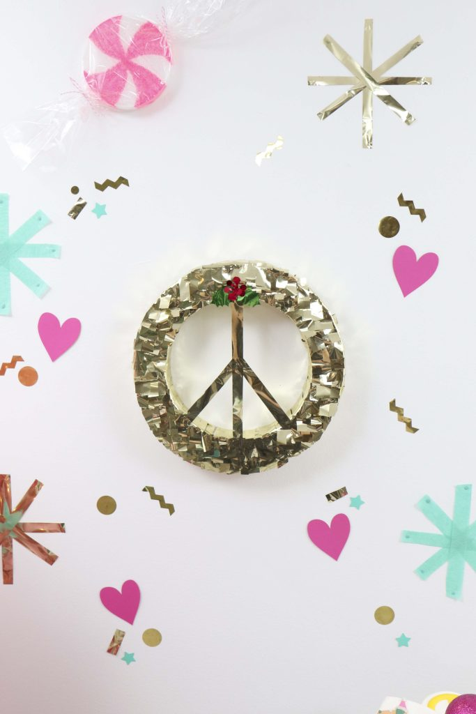 Making Spirits Bright Neon Holiday Party peace sign decor