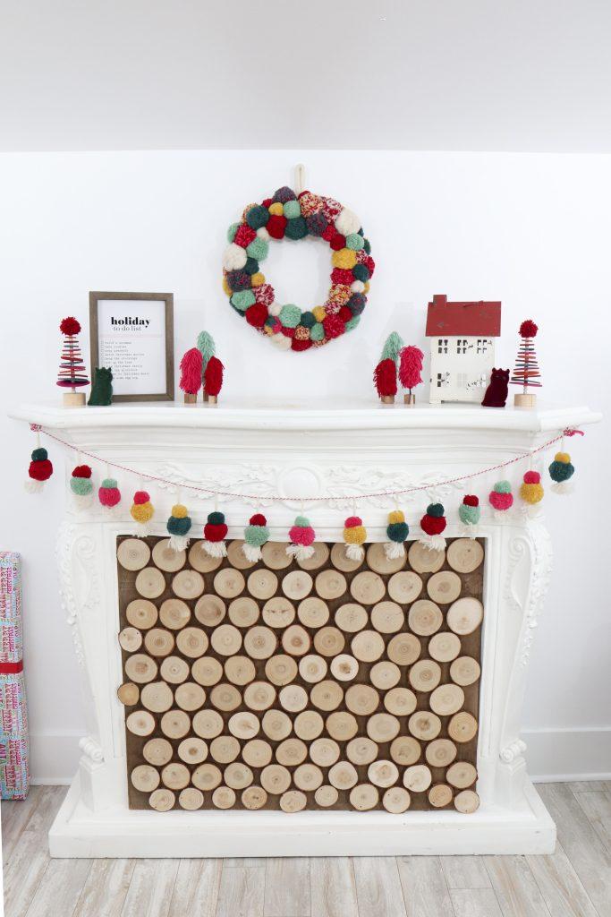Pom Pom Party for the Holidays fireplace decor