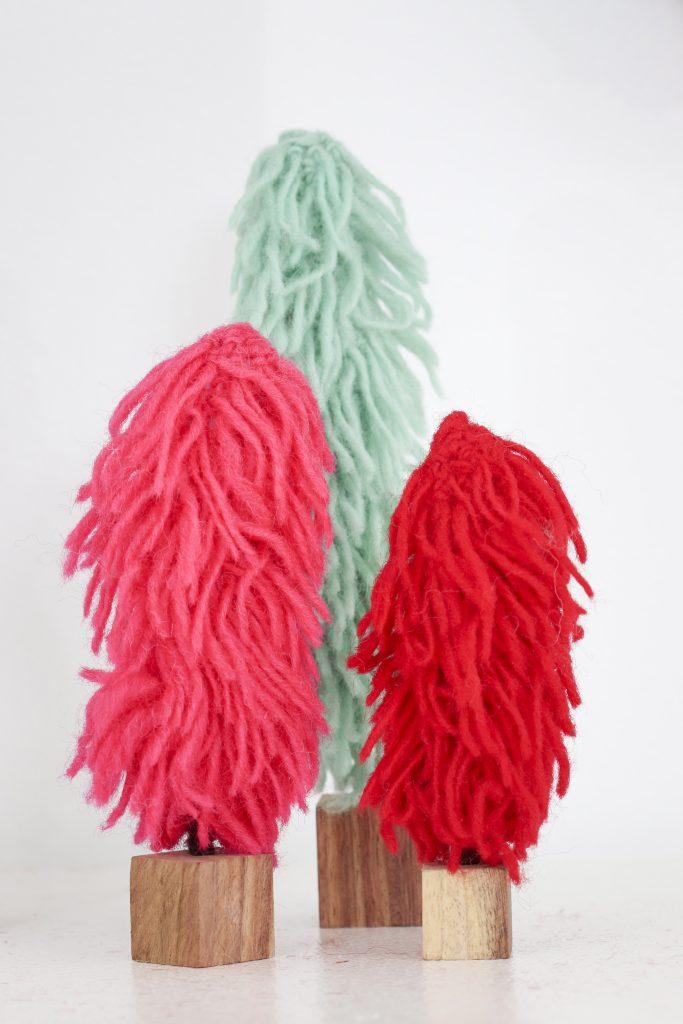 Pom Pom Party for the Holidays mantel decor yarn trees