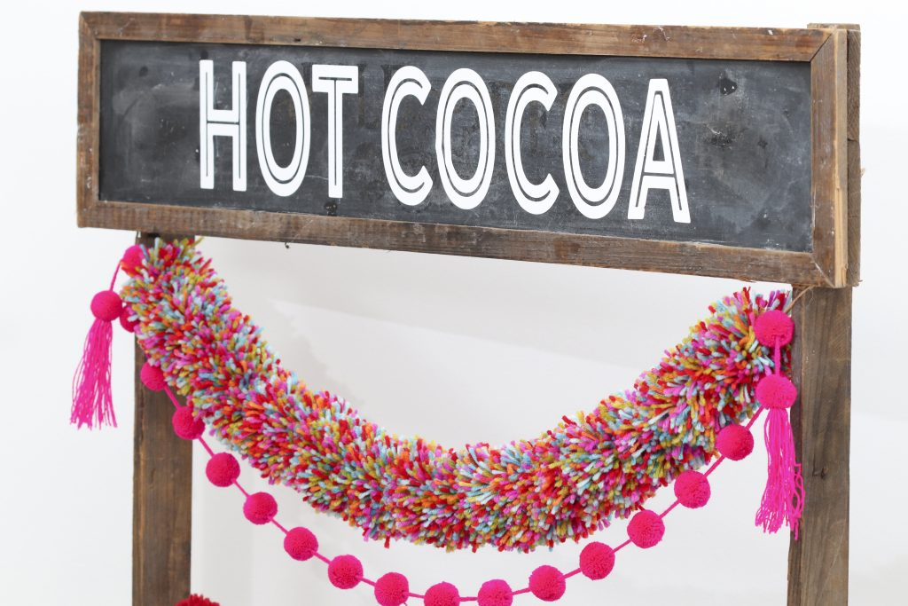 Pom Pom Party for the Holidays hot cocoa station chalkboard sign