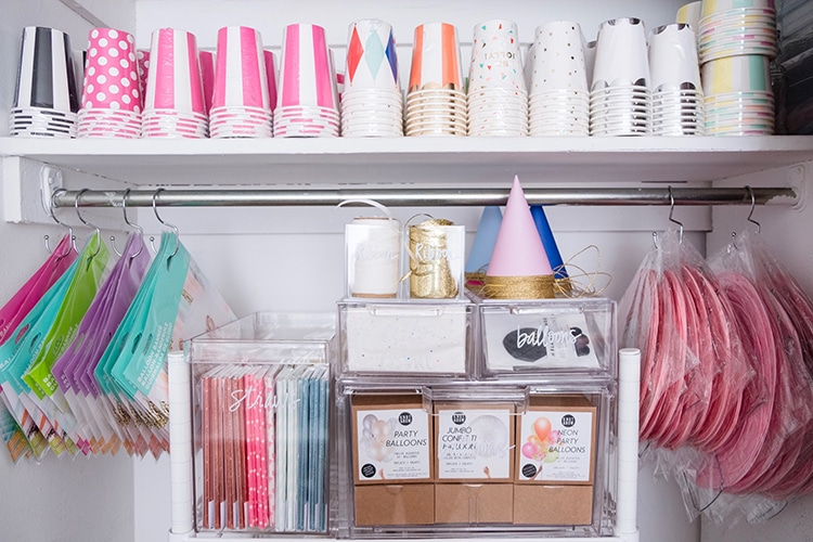 Maximize closet space for party supply organizing by using shower hooks to hang supplies! Get more organizing ideas now at fernandmaple.com.