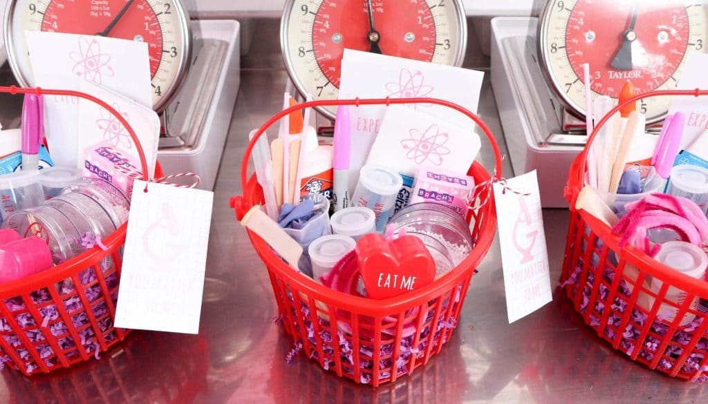 "Create ""Laboratory Kits"" for kids who love to learn this Valentine's Day! Get all of the details for a pink and red Valentine's Day Science Party for kids now at fernandmaple.com!"