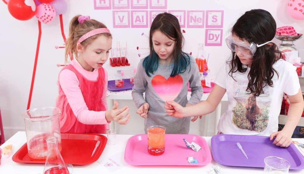"Create a ""Laboratory of Love"" for kids who love to learn this Valentine's Day! Get all of the details for a pink and red Valentine's Day Science Party for kids now at fernandmaple.com!"