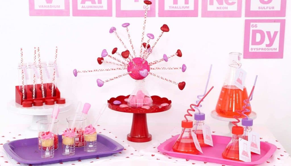"Create a ""Laboratory of Love"" dessert and drink table for kids who love to learn this Valentine's Day! Get all of the details for a pink and red Valentine's Day Science Party for kids now at fernandmaple.com!"