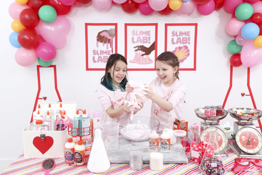 Valentine's Day Slime Party - These fun 15 Valentine's Day Party Ideas for Kids and Teens feature tons of interactive activities, decor inspiration, and DIY dessert recipes! See them all now at fernandmaple.com!