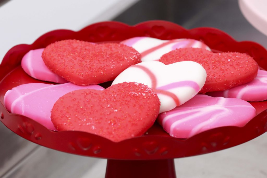Valentine's Day Heart Cookies - Set up a heart-filled Slime Lab for a fun and entertaining Valentine's Day Slime Party for Kids! Plus, how to create to-go Slime Kits for friends! Get details now at fernandmaple.com!