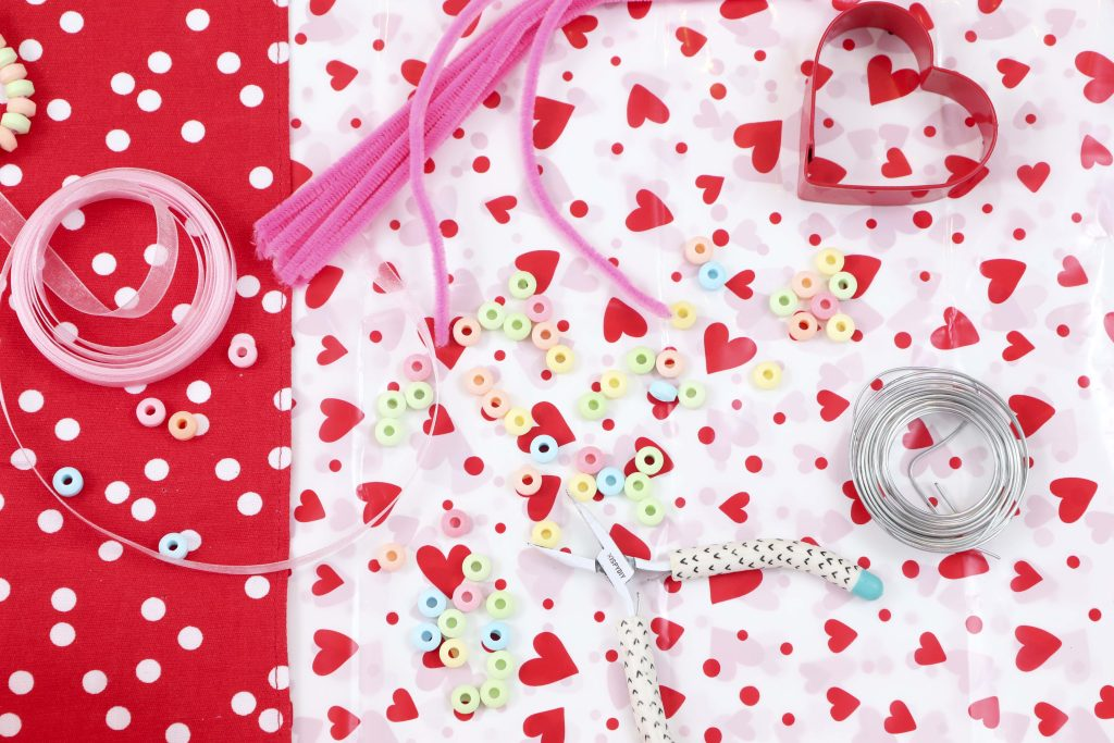 Create cute and edible Valentine's Day Candy Heart Ornaments with kids to hang on a tree or around the house, give as gifts, or treat yourself! Get instructions now at fernandmaple.com!