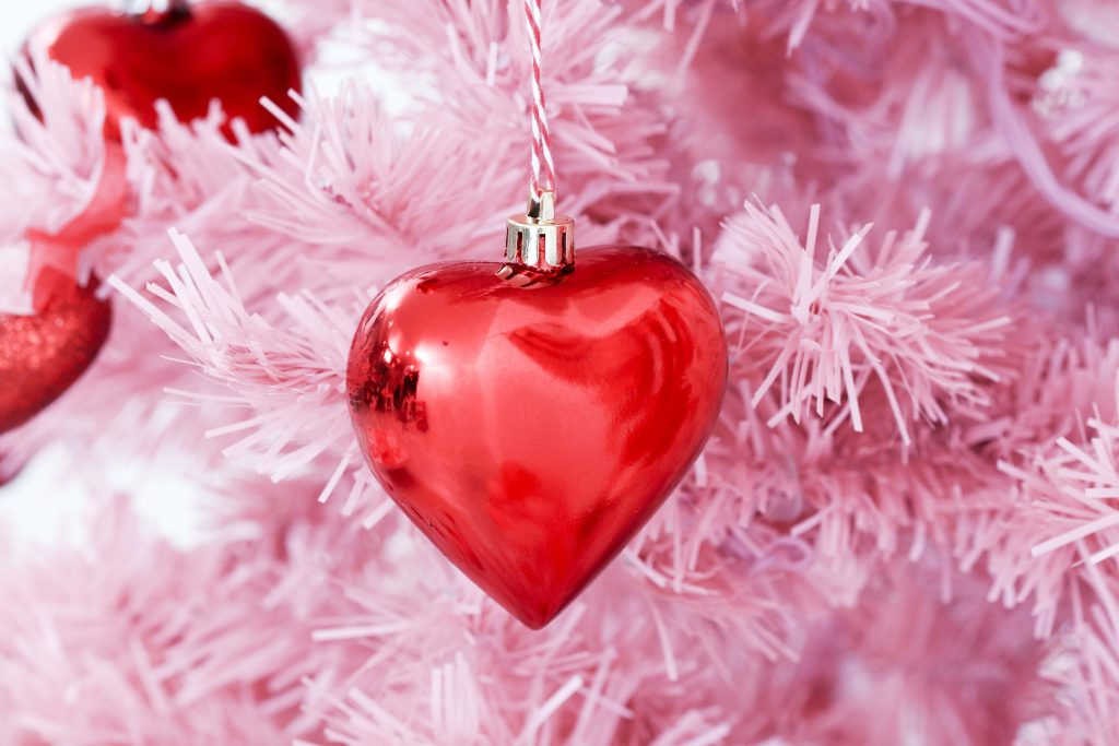 Valentine's Day tree ornaments- decorate a Valentine's Day tree at a tree decorating party with fun backdrop, decor, and candy heart ornament craft! Get details now at fernandmaple.com.