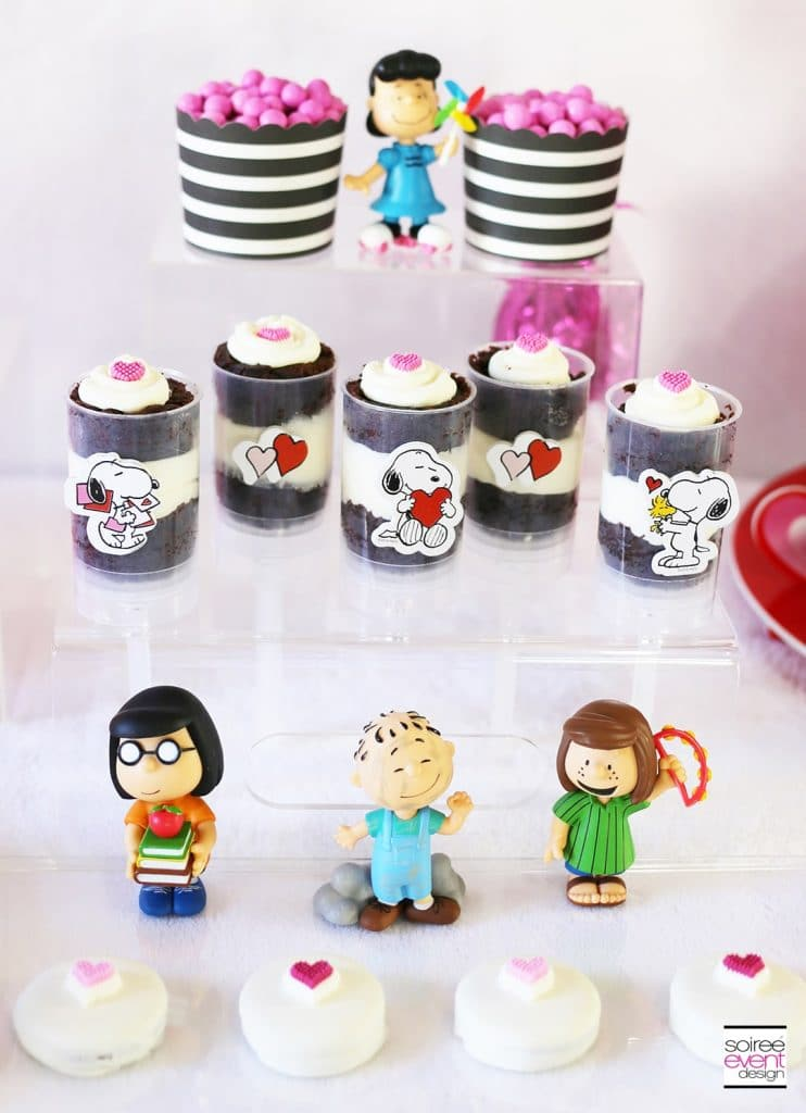 Peanuts Themed Valentine's Day Party - These fun 15 Valentine's Day Party Ideas for Kids and Teens feature tons of interactive activities, decor inspiration, and DIY dessert recipes! See them all now at fernandmaple.com!
