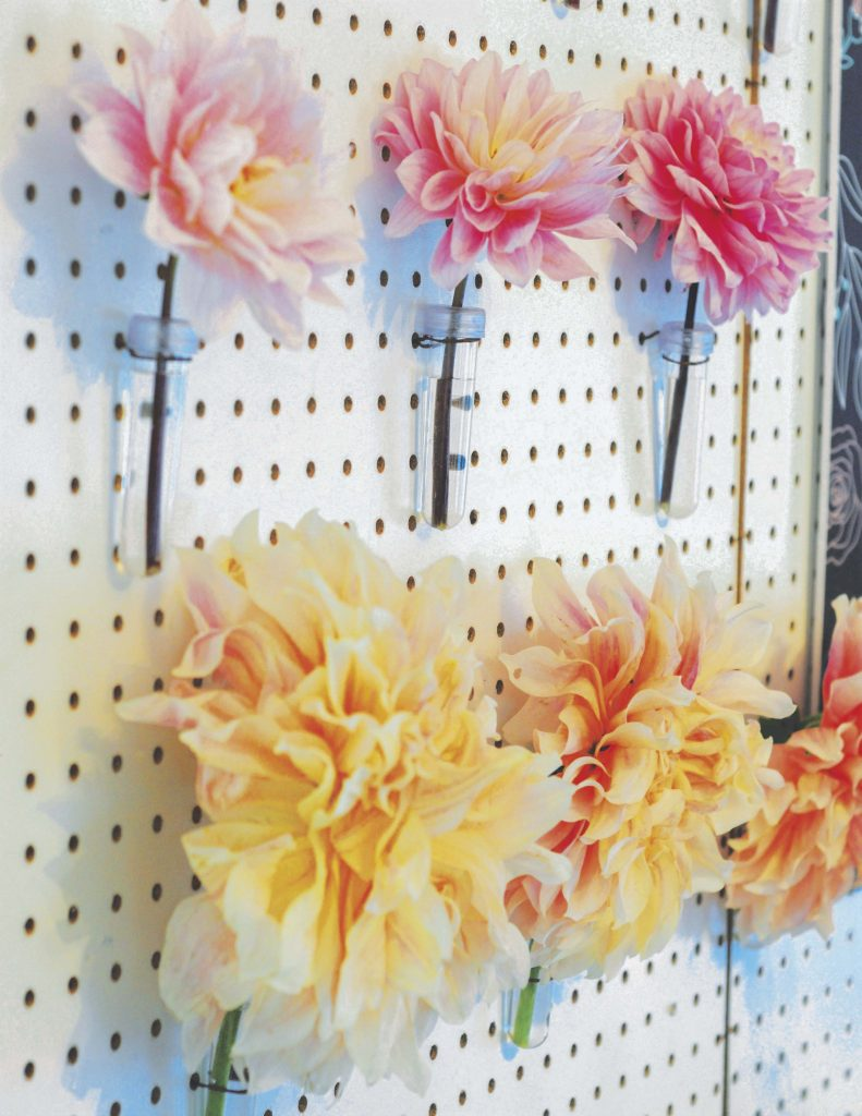 Floral Pegboard Backdrop for a floral arranging party - get details now at fernandmaple.com!