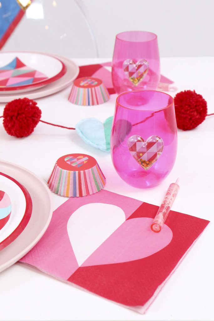 Colorful and modern Geometric Heart Valentine's Day Party table settings - Get details and more party ideas now at fernandmaple.com!