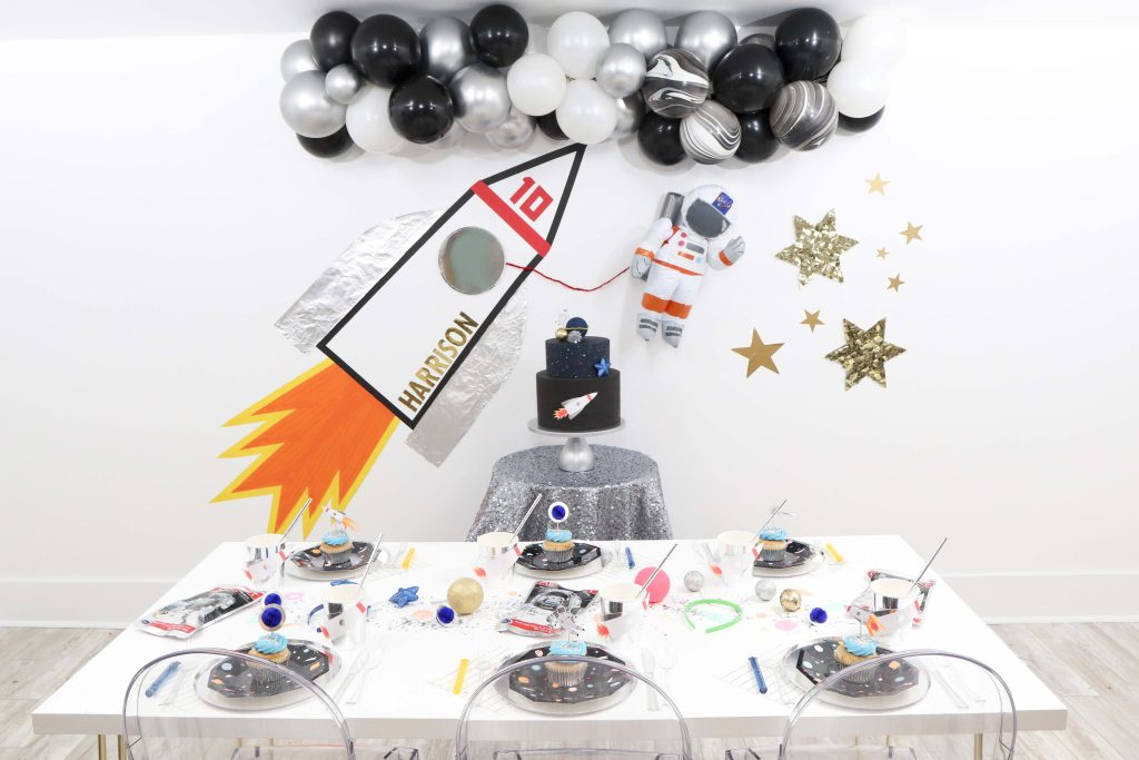 """Looking to throw a Space or Rocket themed birthday? Check out this game-changing """"party in a box"""" recommendation as well as tips for personalizing the party! Get details now at fernandmaple.com."""