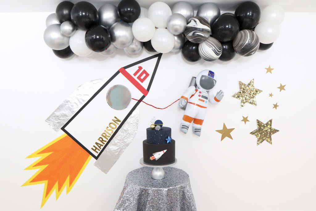 """Space Party Inspiration - Looking to throw a Space or Rocket themed birthday? Check out this game-changing """"party in a box"""" recommendation as well as tips for personalizing the party! Get details now at fernandmaple.com."""