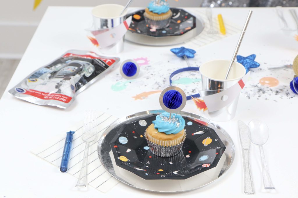 """Space Party Place Settings - Looking to throw a Space or Rocket themed birthday? Check out this game-changing """"party in a box"""" recommendation as well as tips for personalizing the party! Get details now at fernandmaple.com."""