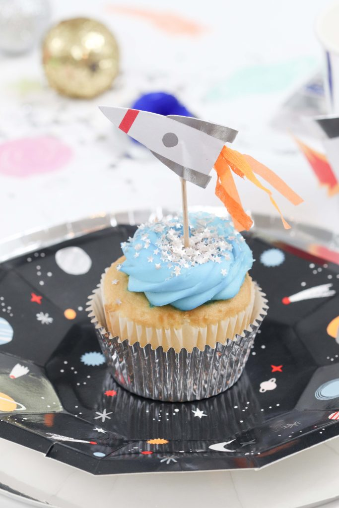 """Space Party Cupcakes - Looking to throw a Space or Rocket themed birthday? Check out this game-changing """"party in a box"""" recommendation as well as tips for personalizing the party! Get details now at fernandmaple.com."""