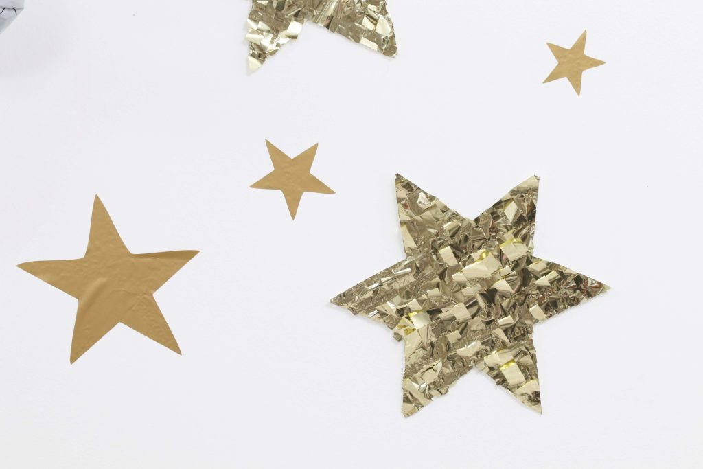 """Space Party Star Backdrop - Looking to throw a Space or Rocket themed birthday? Check out this game-changing """"party in a box"""" recommendation as well as tips for personalizing the party! Get details now at fernandmaple.com."""