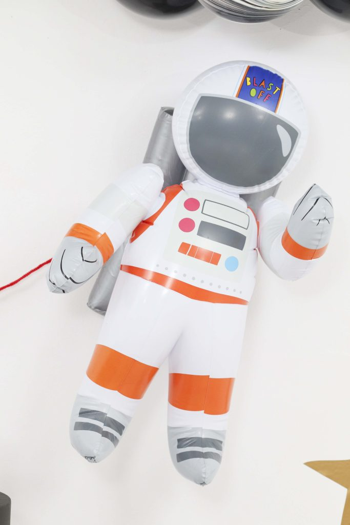 """Space Party Astronaut Decor - Looking to throw a Space or Rocket themed birthday? Check out this game-changing """"party in a box"""" recommendation as well as tips for personalizing the party! Get details now at fernandmaple.com."""