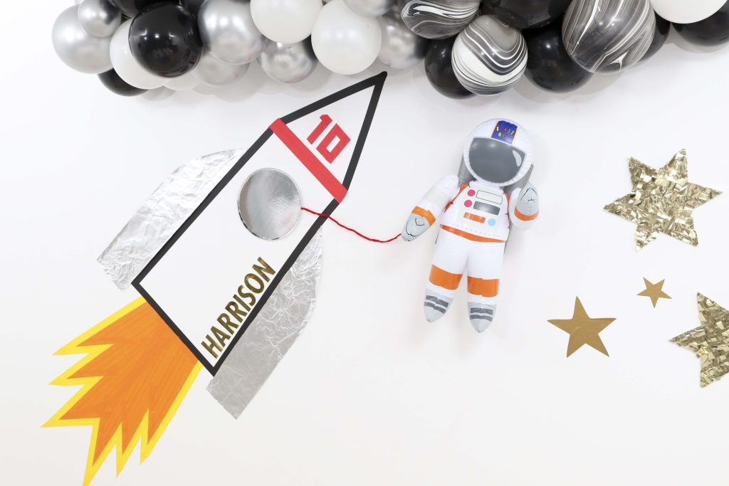 Create this easy DIY Rocket Ship Backdrop for an Outer Space Party for Kids using basic and cheap materials! Get the full step-by-step instructions now at fernandmaple.com!