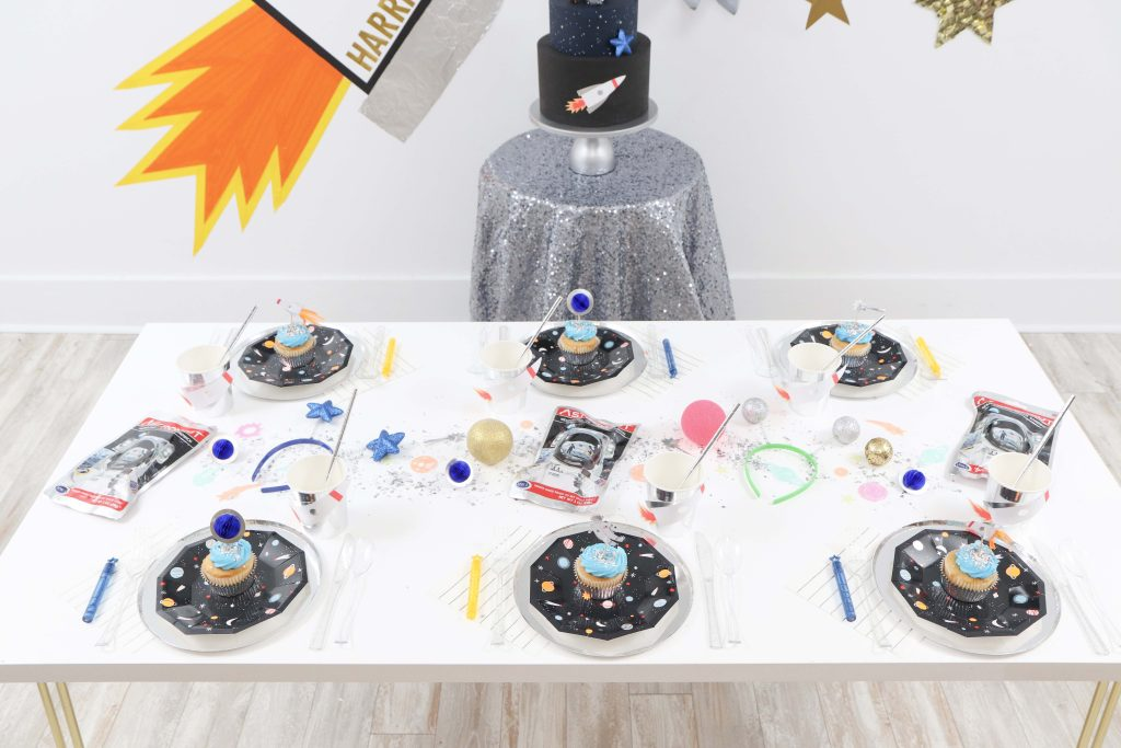 """Space Party Table Setting - Looking to throw a Space or Rocket themed birthday? Check out this game-changing """"party in a box"""" recommendation as well as tips for personalizing the party! Get details now at fernandmaple.com."""