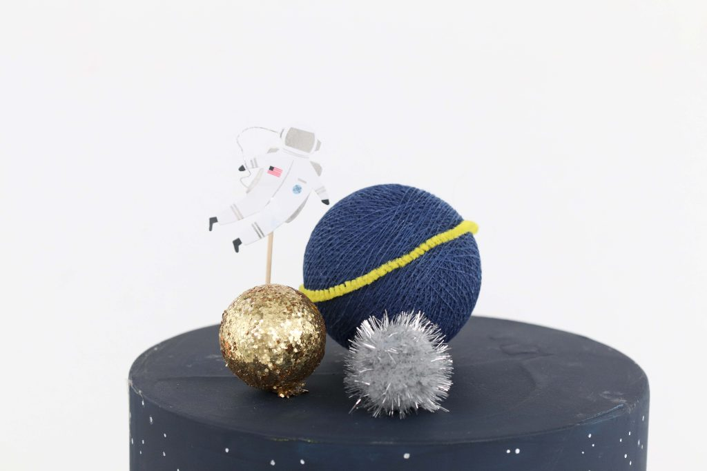 """Space Party Cake Topper - Looking to throw a Space or Rocket themed birthday? Check out this game-changing """"party in a box"""" recommendation as well as tips for personalizing the party! Get details now at fernandmaple.com."""