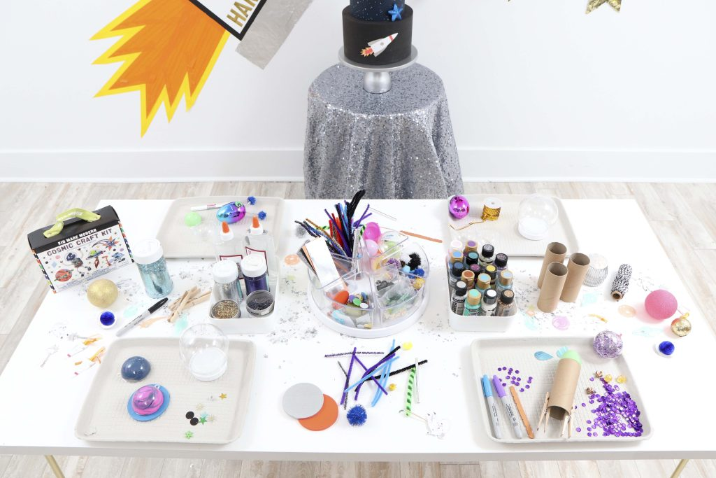 """Space Party Craft Table - Looking to throw a Space or Rocket themed birthday? Check out this game-changing """"party in a box"""" recommendation as well as tips for personalizing the party! Get details now at fernandmaple.com."""