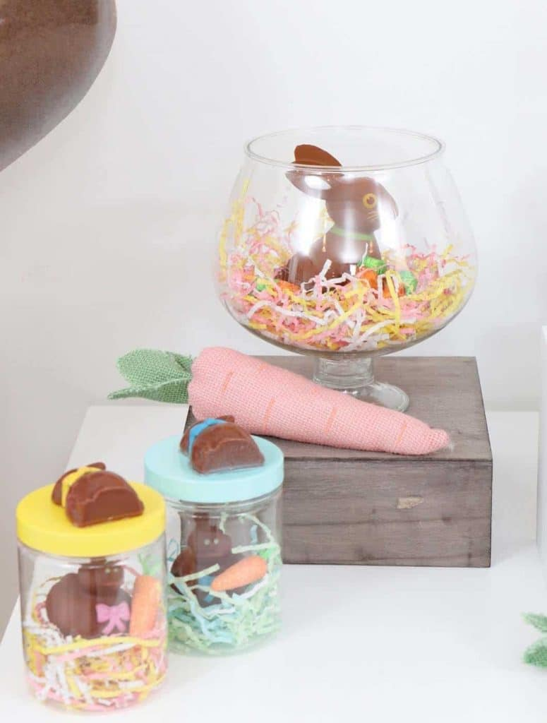 Chocolate Bunny Easter Party decor in glass containers and DIY treat jar favors- get more Chocolate Bunny Easter Party inspiration now at fernandmaple.com!