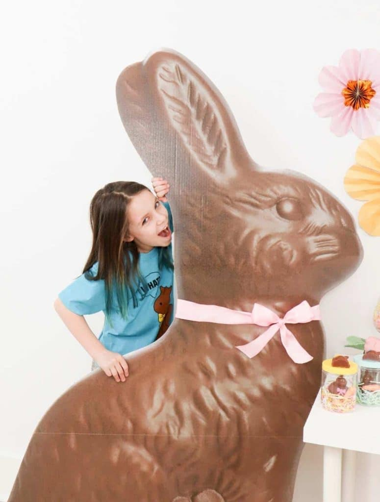Giant Chocolate Bunny Easter Stand, perfect for photo ops - get more Chocolate Bunny Easter Party inspiration now at fernandmaple.com!