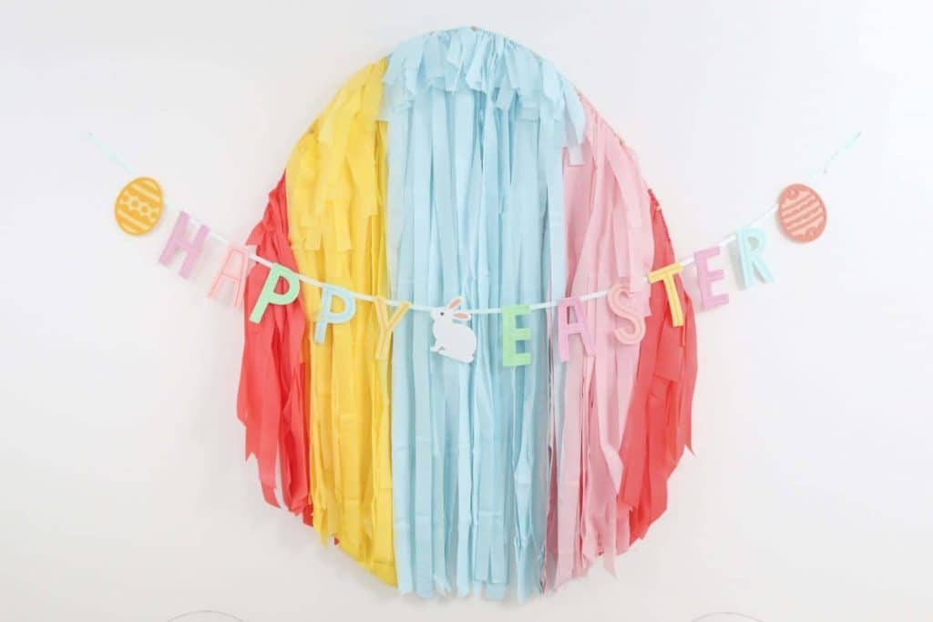 Easter Egg Fringe Backdrop - Get details and more Easter party inspiration now at fernandmaple.com!