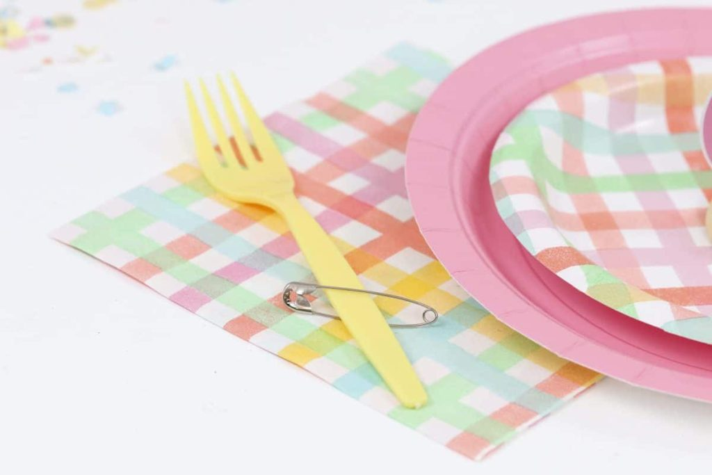 Yellow fork with safety pin embellishment for a Punk Rock Gnome Easter Table Setting - get more party ideas at fernandmaple.com!