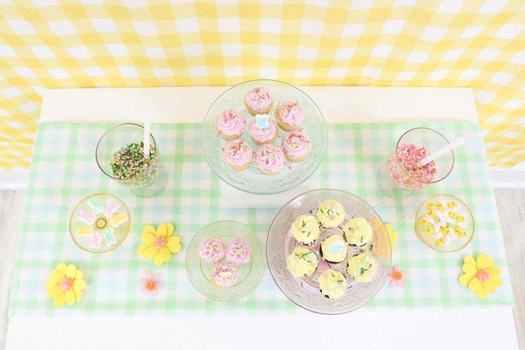 Spring dessert table using yellow and green gingham tablecloths - get more Spring party inspiration now at fernandmaple.com!
