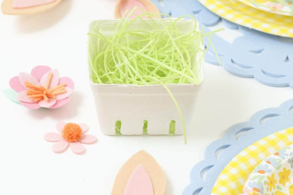 Edible grass in berry baskets for a Spring Gingerbread House decorating party - get more Spring Party inspiration now at fernandmaple.com!