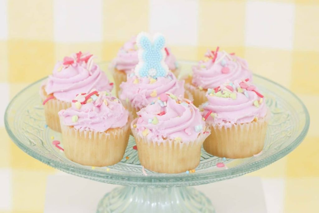 Pastel pink Easter cupcakes on a pale blue stand - get more Spring Party inspiration now at fernandmaple.com!