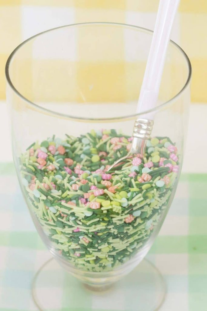 Jar of Spring sprinkles for a Spring Gingerbread House decorating party - get more Spring Party inspiration now at fernandmaple.com!