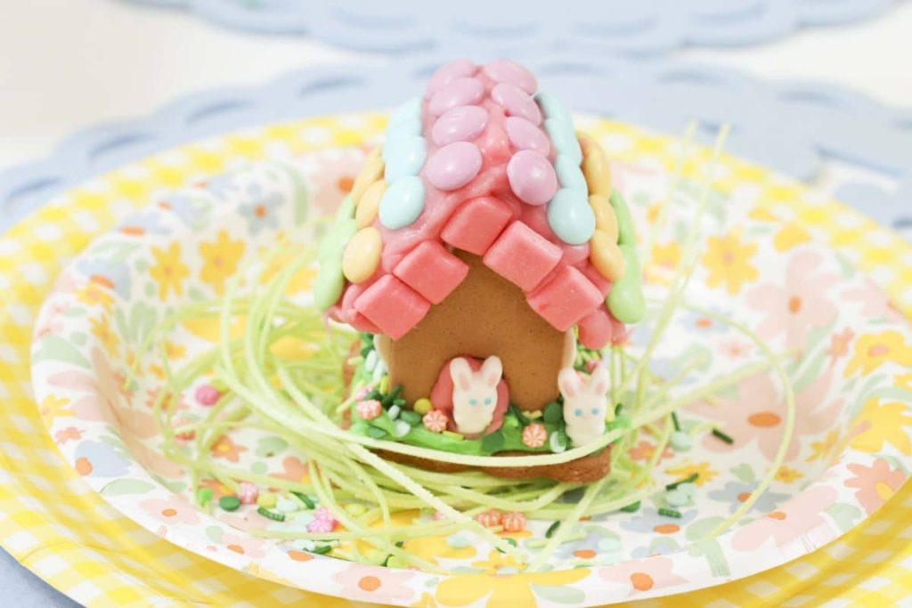 Decorated house from a Spring Gingerbread House decorating party - get more Spring Party inspiration now at fernandmaple.com!