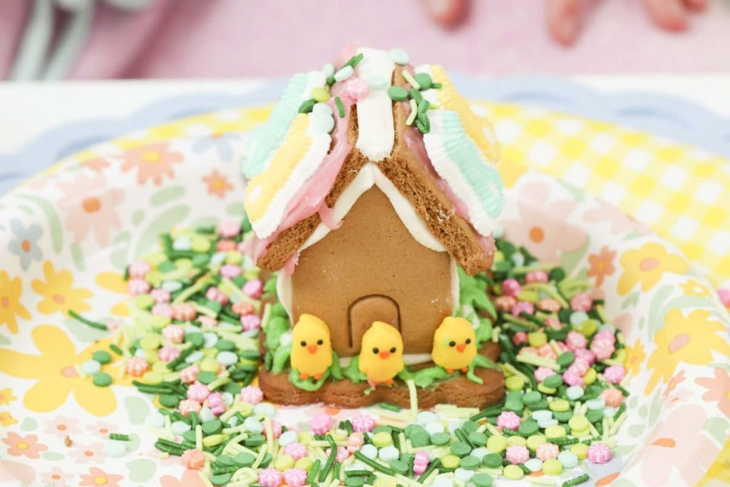 Decorated Spring Gingerbread house from a Spring Gingerbread House decorating party - get more Spring Party inspiration now at fernandmaple.com!